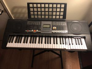 Electronic keyboard piano with stand and music rest for Sale in San Diego, CA