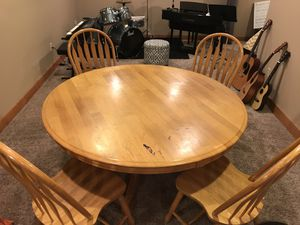 Solid oak dining table and 4 chairs. 58 inches diameter for Sale in Westerville, OH