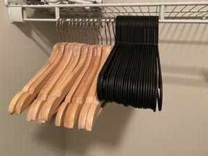 16 Wooden + 50 plastic cloth hangers for Sale in Orlando, FL