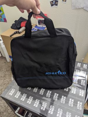 Athletico carrying duffle bag, slim tall bag , black with blue design for Sale in Las Vegas, NV