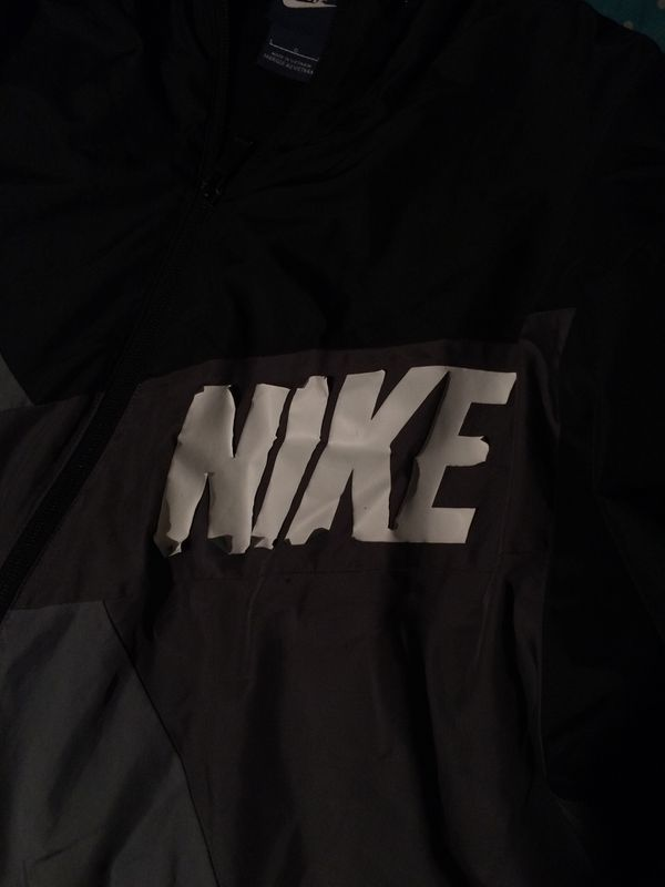 black grey and white nike windbreaker