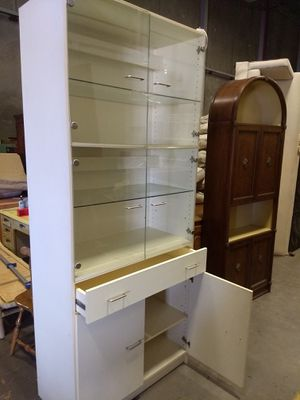 Tall glass cabinet for Sale in Scottsdale, AZ
