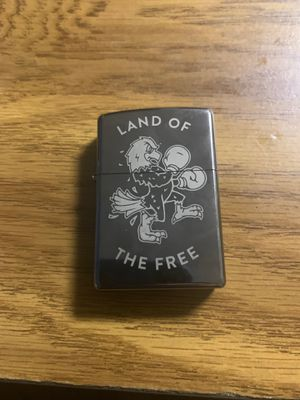 Land of the free huckleberry Zippo Lighter with flint for Sale in Phoenix, AZ