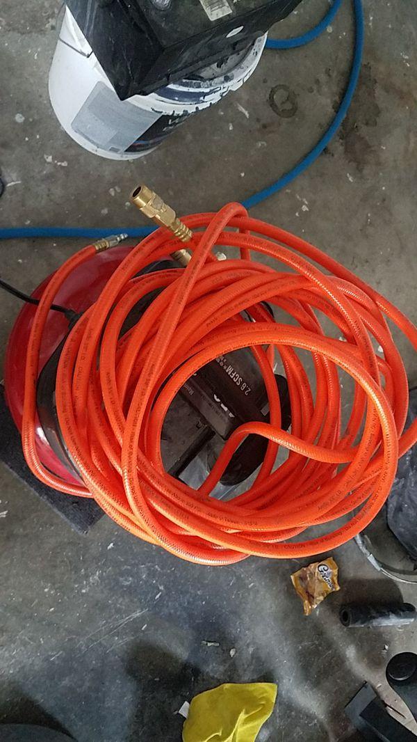 Air compressor with hose