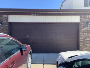 Garage door with motor insulated size 7X16 2 cars size good condition it's been already taken down and its 5 years old for Sale in Sterling Heights, MI