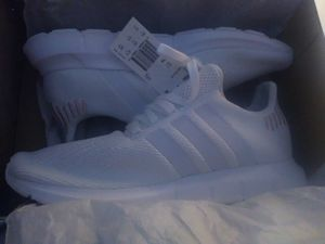Adidas. Size 10. All white with a little gold on the back of the shoe. for Sale in Austin, TX