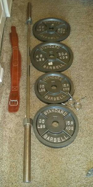 """Olympic 2"""" iron weights pair of 45s and 35s. 45lb 7 foot Olympic barbell, 2 weight clips, weight lifting belt. 205lbs total. for Sale in Deerfield Beach, FL"""