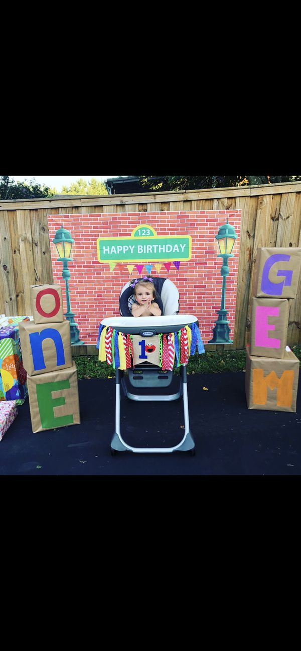 Elmo, big bird, Cookie Monster,& Oscar signs, brick happy birthday wall, me want cookie picture, and Elmo 1 high chair banner