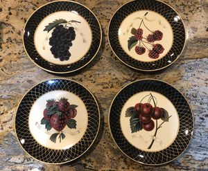 Raymond Waites Collectible decorative set of four dinner plates kitchen fruit black gold for Sale in Marietta, GA