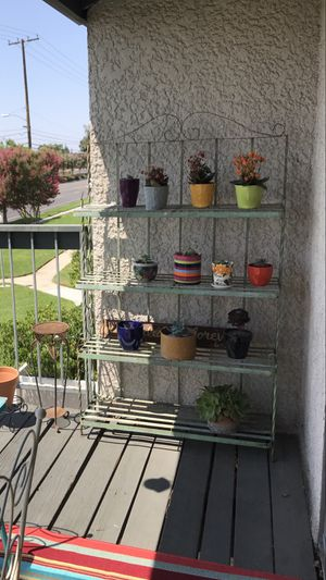 Vintage chippy heavy iron plant stand for Sale in Alta Loma, CA