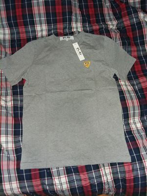 Comme des garcons gray and gold hearted tee size L for Sale in Cheyenne, WY