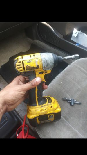 Dewalt drill wrench with adapter and battery for Sale in Hilmar, CA