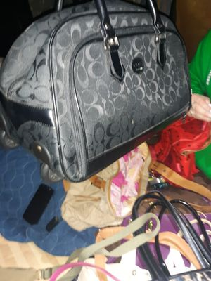 Coach mini suitcase on wheels and telescoping handle for Sale in St. Louis, MO