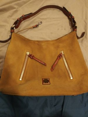 Suede Dooney & Bourke hobo style really nice leather strap handle and really nice bag very well put together there is a little suede dirtiness for Sale in Austell, GA
