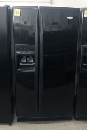 """Comes with free 6 Months Warranty-like new 33"""" inches wide black side by side refrigerator Whirlpool for Sale in Warren, MI"""