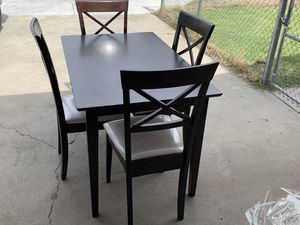 Table with four seat for sale for Sale in Sanger, CA