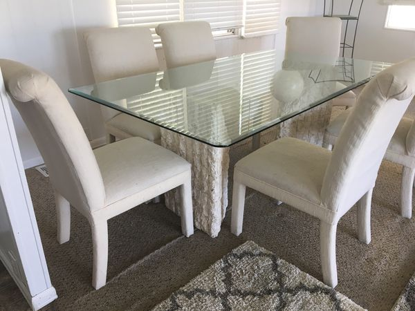 ($425)THE BEST BUY Real nice glass top dining table with six chairsVery unusual Bass different