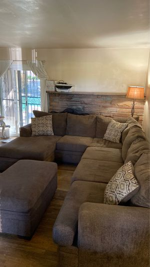 AKI HOME BROWN SECTIONAL 3 piece and storage ottoman for Sale in Pomona, CA