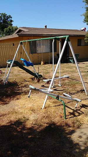 Swing set with teeter totter , and 1swing for a toddler and two swings.with a seesaw and and slide. Everyone. have grow. up for Sale in Moreno Valley, CA