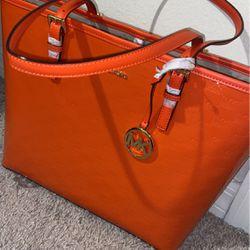 Orange Michael Kohrs Bag for Sale in Kissimmee,  FL