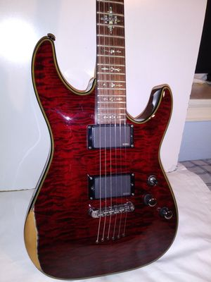 TRADE Your XBOX ONE/ 1 TB OR MORE, for my schecter damien elite electric. Guitar going for $400 + used on ebay. great action. E.m.g. pickups. for Sale in Portland, OR