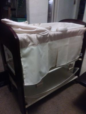 Baby wood bassinet with changing table for Sale in Hayward, CA