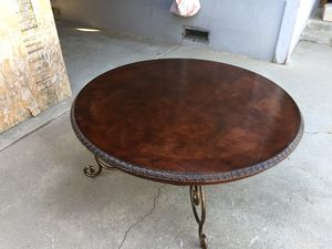Round coffee table with metal frame in good condition. Dimension tall 19 inches wide 44 x 44 inches. for Sale in Fresno, CA