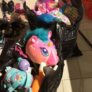 2 big black bags full of girl toys chair skating bike accessories dolls barbies stuffed animals for Sale in Fort Lauderdale, FL
