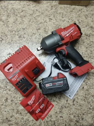 Milwaukee M18 FUEL 18-Volt Lithium-Ion Brushless Cordless 1/2 in. Impact Wrench w/Friction Ring Kit w/One 5.0 Ah Battery, Charger and Bag for Sale in Chicago, IL
