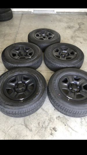Brand new factory Jeep Wrangler set of five 17 inch wheels and tires with a Bridgestone dueler 245/75/17 for Sale in Modesto, CA