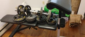 Bench with Olympic weights and bars for Sale in Federal Way, WA