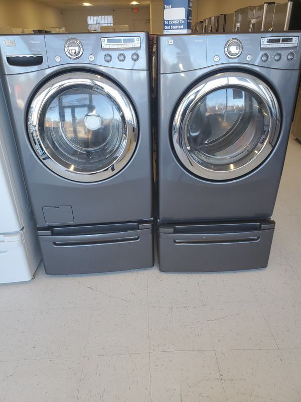 LG washer and electric dryer set with pedestal in excellent condition