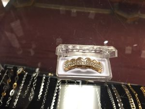 Gold color and zirconia grills for Sale in Hartford, CT