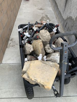 Free sprinklers - Must take stones in barrel and wood in pictures for Sale in Long Beach, CA