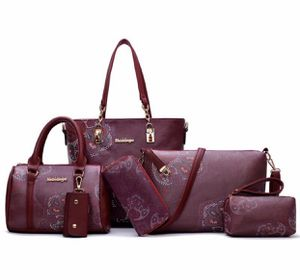 Burgundy floral designer bag set for Sale in San Antonio, TX