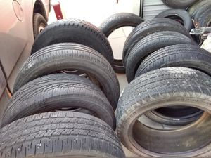 26 nearly new tires and a 1950s Jon boat for Sale in Pueblo, CO