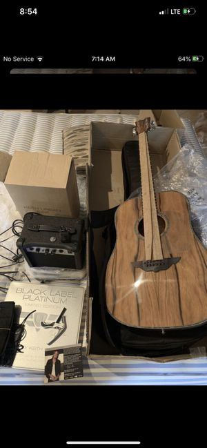 Brand new Keith urban electric acoustic guitar with amplifier and disc set bundle for Sale in Plant City, FL