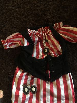 Female pirate top and vest. Can wear top over or on the shoulder. Can cinch up the vest. Wear with black skirt or pants and some boots. for Sale in Norco, CA