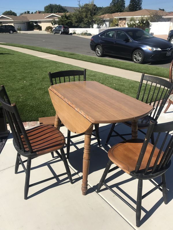 Wood table And Four Chairs Great Condition Has A Leaf To Expand The Table