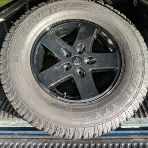 4 Jeep Wheels And Tires 5x5 Lug for Sale in Kirkland, WA
