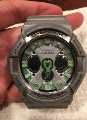 G- Shock silver with Green accents for Sale in Los Angeles, CA