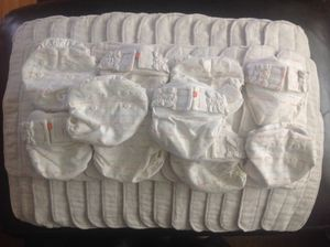 SIZE X-SMALL (NEWBORN) GDIAPERS WITH UMBILICAL CORD SNAP DOWN AND 44 CLOTH INSERTS for Sale in New Cumberland, PA