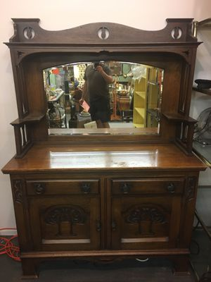 1910 Hand Carved Antique dresser bureau with mirror or a bar can be used for dishes like a china cabinet or a dresser for clothes etc. BUFFET for Sale in Orange, CA