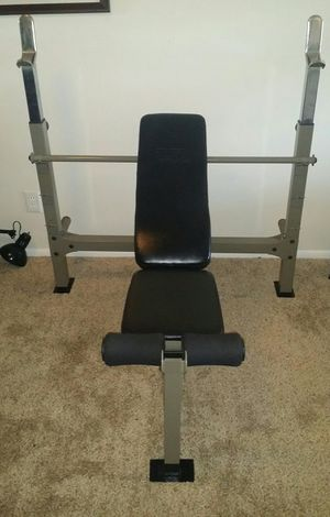 TSA olympic weight bench. Heavy duty bench that does regular, decline and 2 inclines. Has weight holder built in and can be used for squats. for Sale in Deerfield Beach, FL