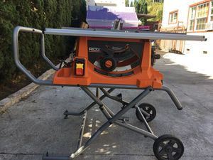 """15 amp. Corded 10"""" in heavy duty portable table saw whit stand. Rigit for Sale in Los Angeles, CA"""