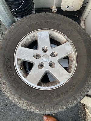 Toyo Open Country AT II Size P265/70R17 Tires on Jeep wheels 5x5 for Sale in Seattle, WA