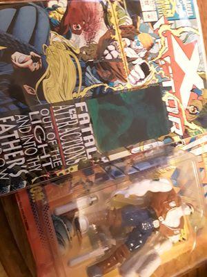 X-MEN RANDOM FIGURE AND CHROMIUM COMIC BOOK for Sale in Mason City, IA