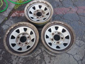 3 wagon wheel style stock Ford rims, 5 on 5.5 fits Dodge 15 inch for Sale in Montebello, CA