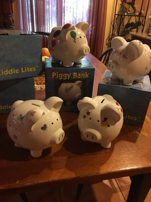 Brand New Piggy Banks Assorted Designs with stoppers for Sale in Lake Wales, FL