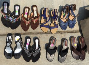 Sandals Ladies New $15 each (NEW Except black pair on far left front row & blue pair far right 2nd row used once), sizes 7.5 to 8 for Sale in Sanger, CA